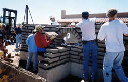 Students at the Spring's Tucson Class work on an adobe wall at Old Pueblo Adobe Co, Tucson, AZ